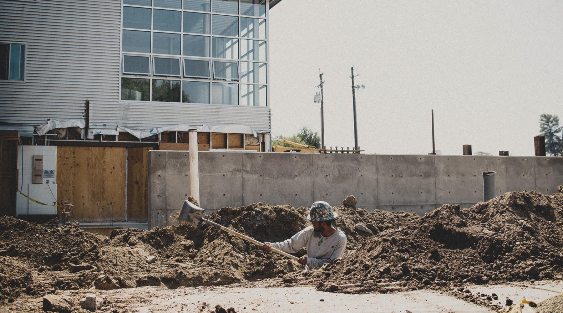 man digging in dirt.